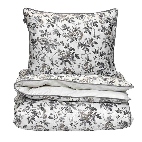 """Sekä pussilakanan, että tyynyliinan kääntöpuoli on vaalea ja kevyesti """"pohjakuvioitu""""."""